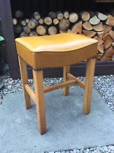 Vintage old solid wood mustard coloured vinyl stool