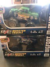 Lot of 2 New Bright R/C Monster Trucks Blue & Green New