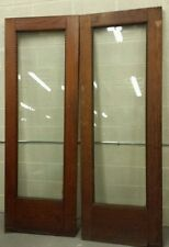 PAIR OF ANTIQUE OAK BEVEL GLASS SWINGING DOORS