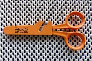 Wilkinson Sword Fiskars Scissors in holder. Cutting edge 7cm. Total length 12.5