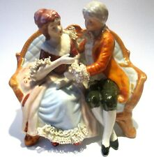 Vintage Porcelain romantic figurine Lady and Lord on sofa