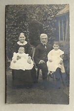 c1900 B/W Photograph. Victorian Grandparents with Grandchildren. Garden Exterior