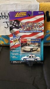 NIB 1/64 JOHNNY LIGHTNING AMERICA'S FINEST NEW ORLEANS POLICE FORD CROWN VIC