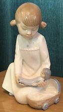 NAO By Lladro Girl Holding Doll With Moses Basket Figurine