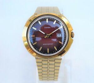 Restored 1974 TIMEX Marlin calendar, oval body, gold-tone