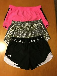 3 PAIR OF WOMENS SIZE MEDIUM UNDER ARMOUR SHORTS.  EXCELLENT COND.