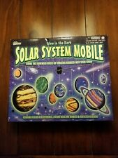 Solar system glow in the dark hanging planets and stickers kit.