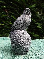 Stone/concrete garden statue ornament of a bird on a stone
