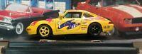 Porsche 911 Carrera Racing Yellow Burago 1/24 Scale Diecast Model