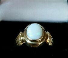 A vintage 9ct yellow gold ring. Collet Set with an Opal cabachon. London 1954