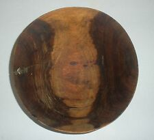 Old carved wood bowl with brass staplelike field repair