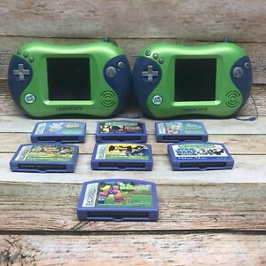 2 X LEAP FROG LEAPSTER 2 HANDHELD LEARNING SYSTEM AND 7 GAME CARTRIDGES LOT