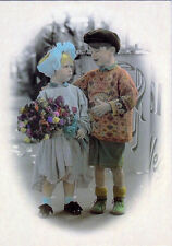 Nicely dressed girl and boy, girl even with flowers! Nice postcard of u/k origin