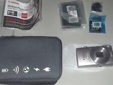 Canon PowerShot ELPH 360 20.2 MP Digital Camera - Silver brand new photo album