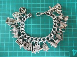 HUGE SOLID SILVER CHARM BRACELET 126.5 GRAMS  HEAVY LINKS WITH  25 CHARMS