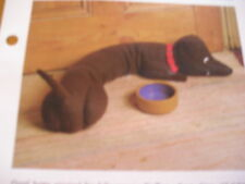 KNITTING PATTERN FOR DOGGY DRAUGHT EXCLUDER/TOY.