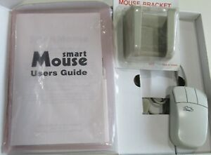 CMD SMART MOUSE FOR COMMODORE. COMES WITH MOUSE CRADLE, MANUAL AND UTILITY DISK
