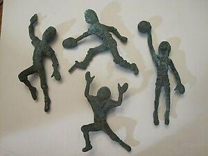 4 vintage cast metal sports figurines-football/baseball/basketball