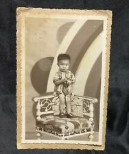 1930's Chinese boy holding a toy  studio photo on card art deco background