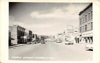 Pierre South Dakota~Main Street~Furniture Co~National Bank Clock~1950s Cars~RPPC