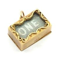 9ct 9carat yellow gold vintage charm/pendant containing an old £1 note