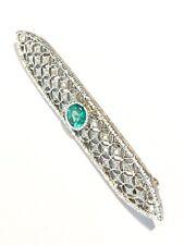spilla in oro bianco 18 Kt con diamanti ct 0,64 e smeraldo