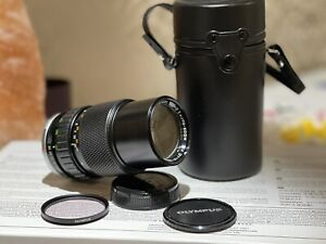 Olympus Zuiko 75-150mm f/4 Camera Lens With Caps And Case Lovely condition.