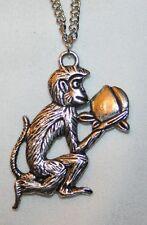 Delightful Textured Silvertone Frolicking Monkey Pendant Necklace