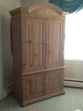 Beautiful Entertainment Center made from pine with lots of character.
