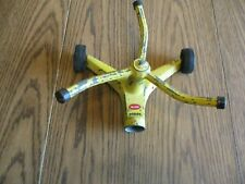 Nelson Metal Poppy 3 Arm Whirling Lawn Sprinkler Yellow with Wheels