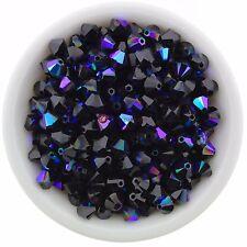 Swarovski Crystal 5328 XILION Bicones 4mm - JET GLACIER BLUE (24 PCS)