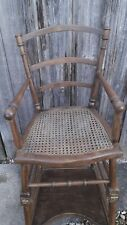 Antique child's metamorphic 2-part hinged wood and cane high chair.