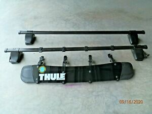 Thule 50 in square load bar roof rack Traverse Foot Pack and Thule 871XT Fairing