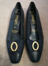 Clarks Images Navy Shoe Size 4 1/2. Bow detail on top and gold heel detail