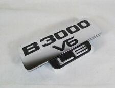 MAZDA B3000 V6 LE EMBLEM 98-03 NEW OEM FRONT FENDER BADGE sign symbol logo
