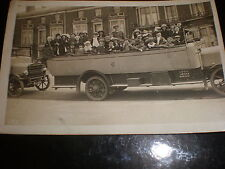 Old postcard group of people in a an open top bus coach c1920s