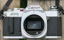 Canon AV-1 Chrome Camera with neck strap.