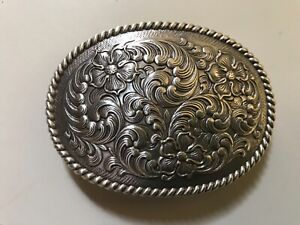 Floral,tooled,unisex,Western,cowboy,rodeo belt buckle. polished silver plaiting.