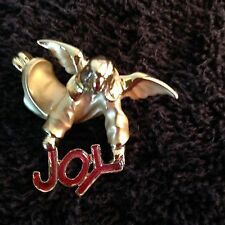Vintage Angel Pin holding the word Joy in red.
