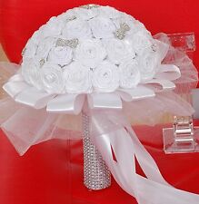 Handmade wedding bouquet with graceful white roses in satin, pearls & brooches