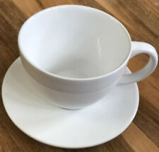 Large white cup and saucer