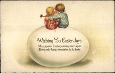 Easter - Kids on Giant Egg - Boy w/ Arm Around Girl c1910 Postcard