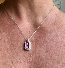 Beautiful Cabochon Ruby and diamond pendant set in 14 karat white gold