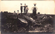 WORKMEN WITH TOOLS POSING AT REMAINS OF DESTROYED BLDG REAL PHOTO POSTCARD 1909