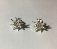 Trendy 8 Angles Star Stud Earrings Lined With White Crystals Silver Tone