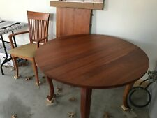 "Dining table and 8 chairs. SOLID CHERRY, Expands from 42"" round to 105"" oval."