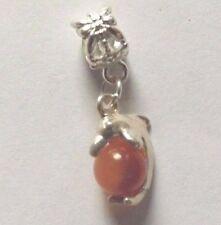 pendentif argenté dauphin perle oeil de chat orange