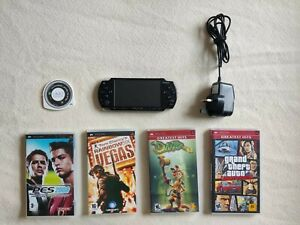 PSP 2003 with Memory Card, Battery, Charger, and Games