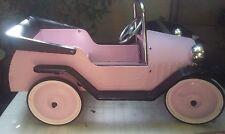 ancienne voiture a pedale en fer rose vintage