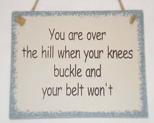 fUnNy sign You are over the hill when your knees buckle and your belt won't